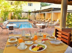 Breakfast by the pool at Amadeus Garden Victoria Falls