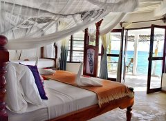 Bedroom with sea view at Aya Beach Bungalows in Unguja