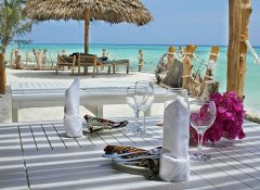 Aya Beach Bungalows's restaurant with sea view in Unguja