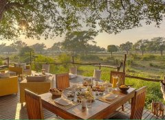Tree house dining deck at Flatdogs Camp in South Luangwa