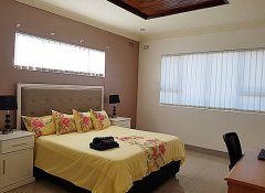 Exquisite bedroom at Grey Oak Holiday House in Bulawayo