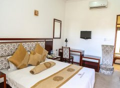 Suite with double bed at Hotel de Mag in Dar es Salaam