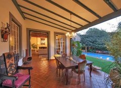 Terrace, garden and pool at Karen Gables in Nairobi