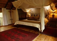 Thatched en-suite Kubu Lodge accommodation in Kasane