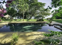 Pool with Chobe river view at Kubu Lodge in Kasane