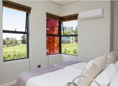 Bedroom with vineyard view at Kunjani Cottages & Wines