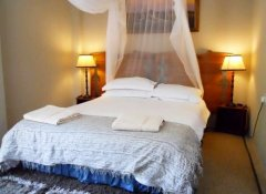 Double room with mosquito net at Lorries Bed & Breakfast