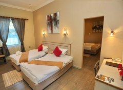 Air-conditioned family room at Minen Hotel in Tsumeb