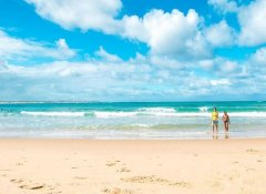 Swimming and surfing at Paradise Dunes in Praia do Tofo