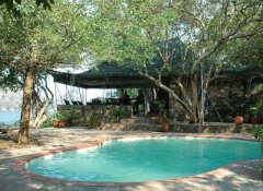 Redcliff Zambezi Lodge's pool and restaurant in Luangwa