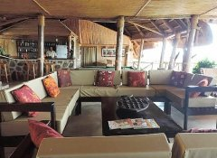 Lounge and restaurant with bar at Ruaha Hilltop Lodge
